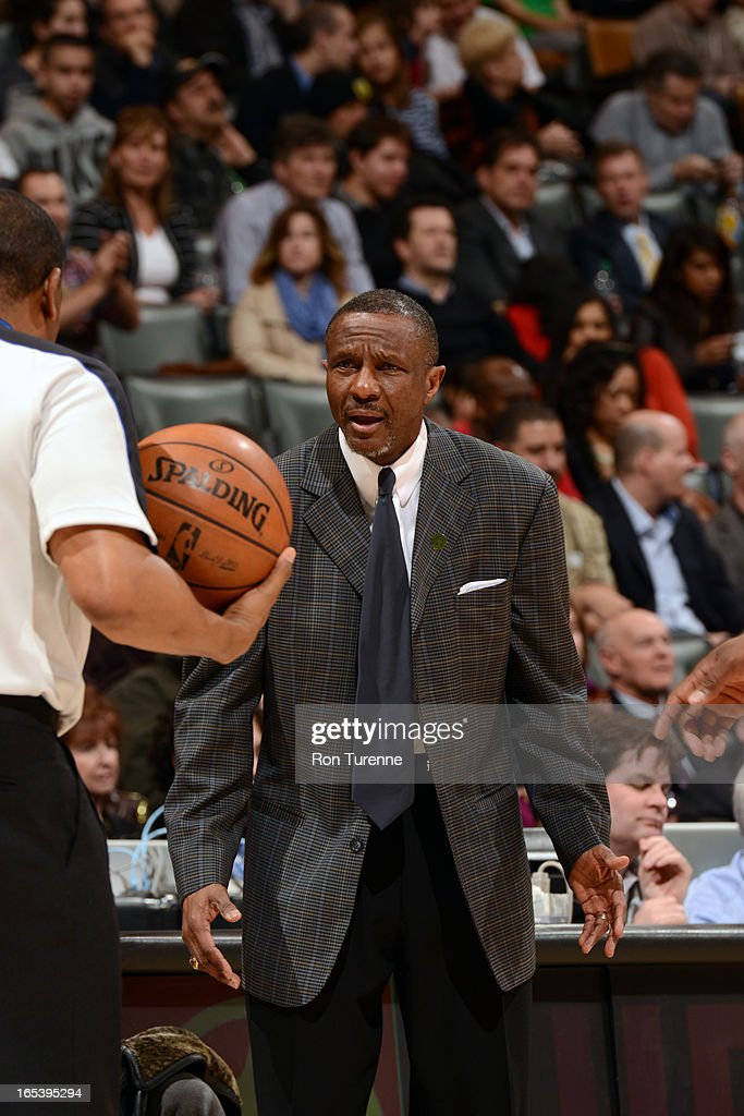 Head Coach Dwane Casey of the Toronto Raptors speask with the ref against the Washington Wizards during the game on April 3, 2013 at the Air Canada Centre in Toronto, Ontario, Canada.