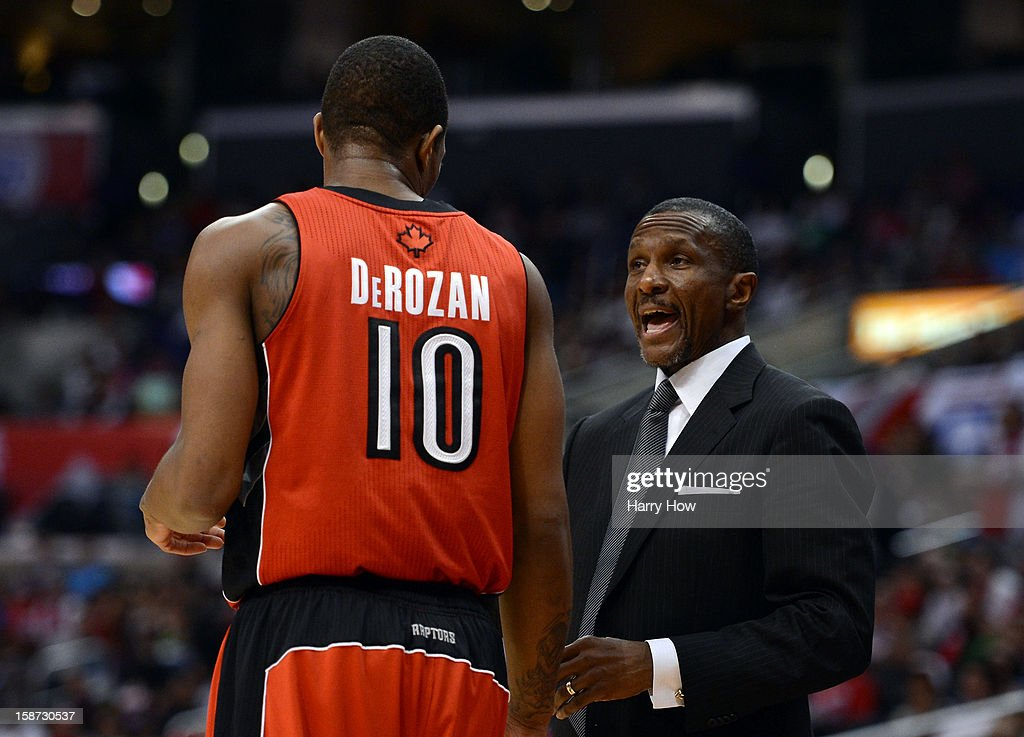 Head Coach Dwane Casey of the Toronto Raptors talks with DeMar DeRozan #10 during a 102-83 Los Angeles Clipper win at Staples Center on December 9, 2012 in Los Angeles, California.