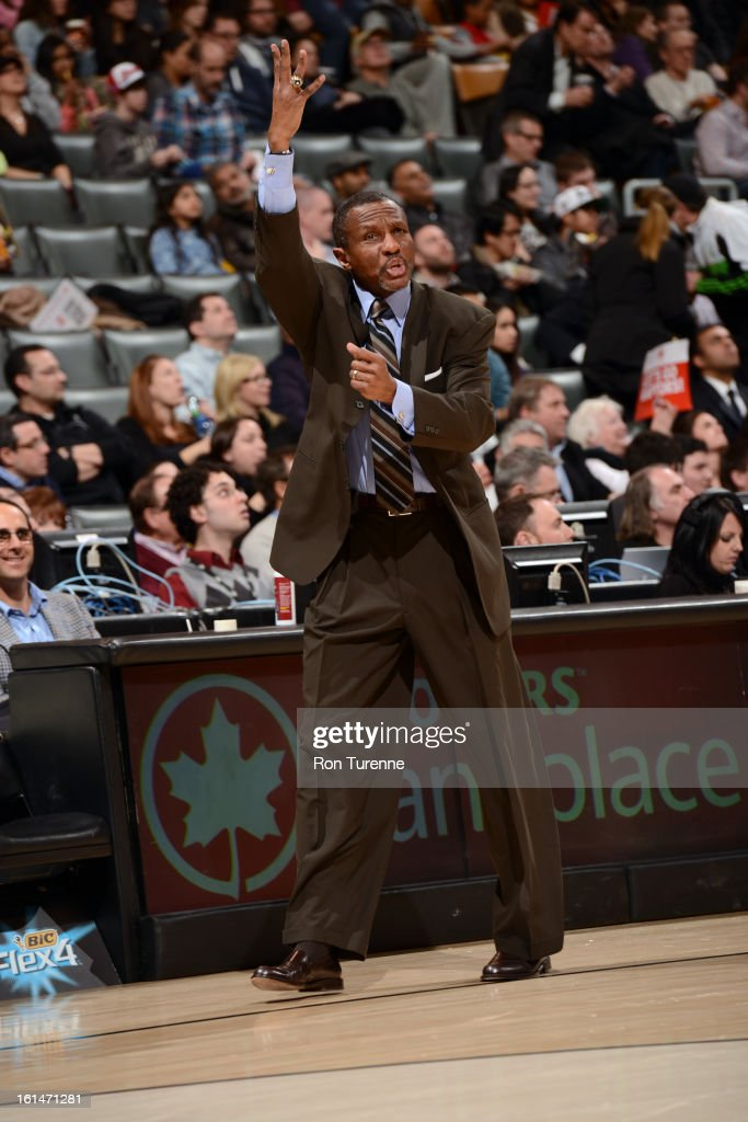 Head Coach Dwane Casey of the Toronto Raptors tells his players to go strong to the basket against the Boston Celtics during the game on February 6, 2013 at the Air Canada Centre in Toronto, Ontario, Canada.