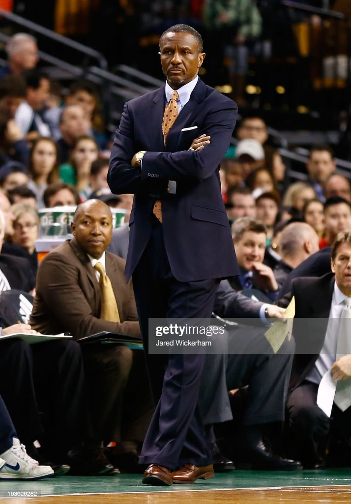 Head coach Dwane Casey of the Toronto Raptors watches his team play against the Boston Celtics during the game on March 13, 2013 at TD Garden in Boston, Massachusetts.