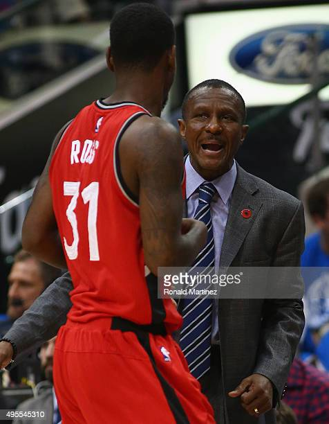 Head coach Dwane Casey talks with Terrence Ross of the Toronto Raptors during play against the Dallas Mavericks at American Airlines Center on...