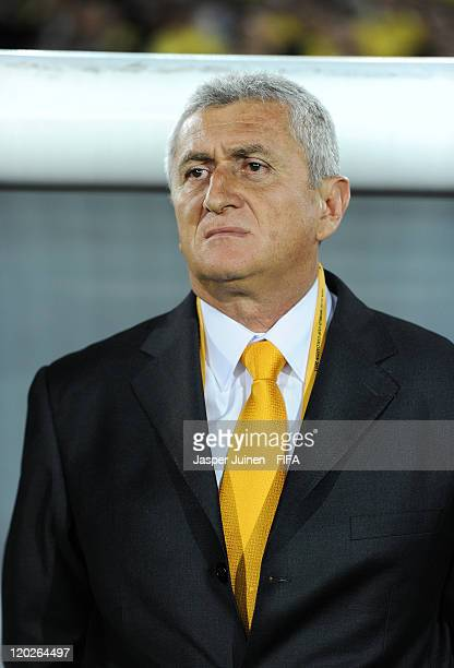 Head coach Eduardo Lara of Colombia listens to his countries national anthem during the FIFA U20 World Cup Colombia 2011 group A match between...