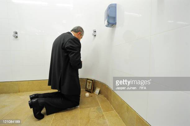 Head coach Eduardo Lara of Colombia prays after lighting a candle in the shower aeria of his team's dressing room prior to the FIFA U20 World Cup...