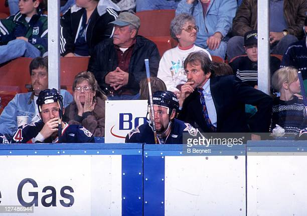 Head coach EJ McGuire of the Hartford Wolf Pack looks on from the bench during an AHL game against the Springfield Falcons on December 5 1997 at the...