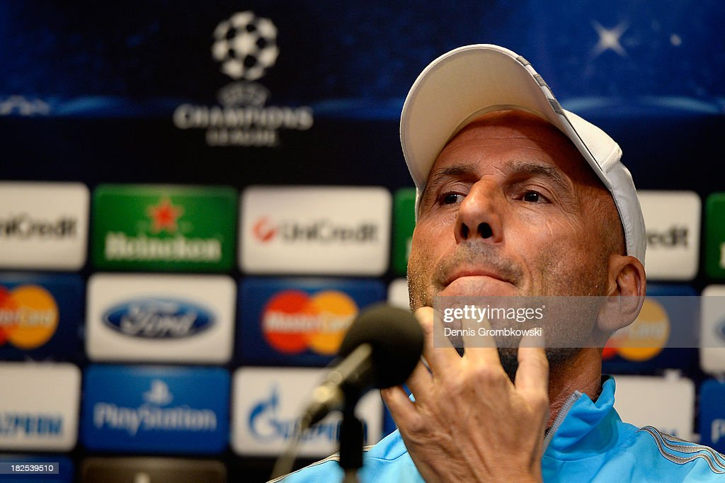 Head coach <a gi-track='captionPersonalityLinkClicked' href=/galleries/search?phrase=Elie+Baup&family=editorial&specificpeople=536928 ng-click='$event.stopPropagation()'>Elie Baup</a> of Olympique Marseille reacts during a press conference ahead of their Champions League match against Borussia Dortmund on September 30, 2013 in Dortmund, Germany.