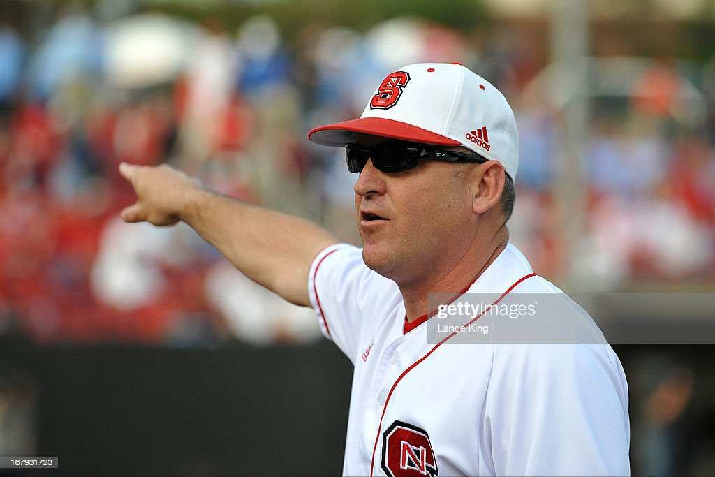 Head Coach Elliott Avent of the North Carolina State Wolfpack points prior to a game against the North Carolina Tar Heels at Doak Field on April 26, 2013 in Raleigh, North Carolina. North Carolina defeated NC State 7-1.