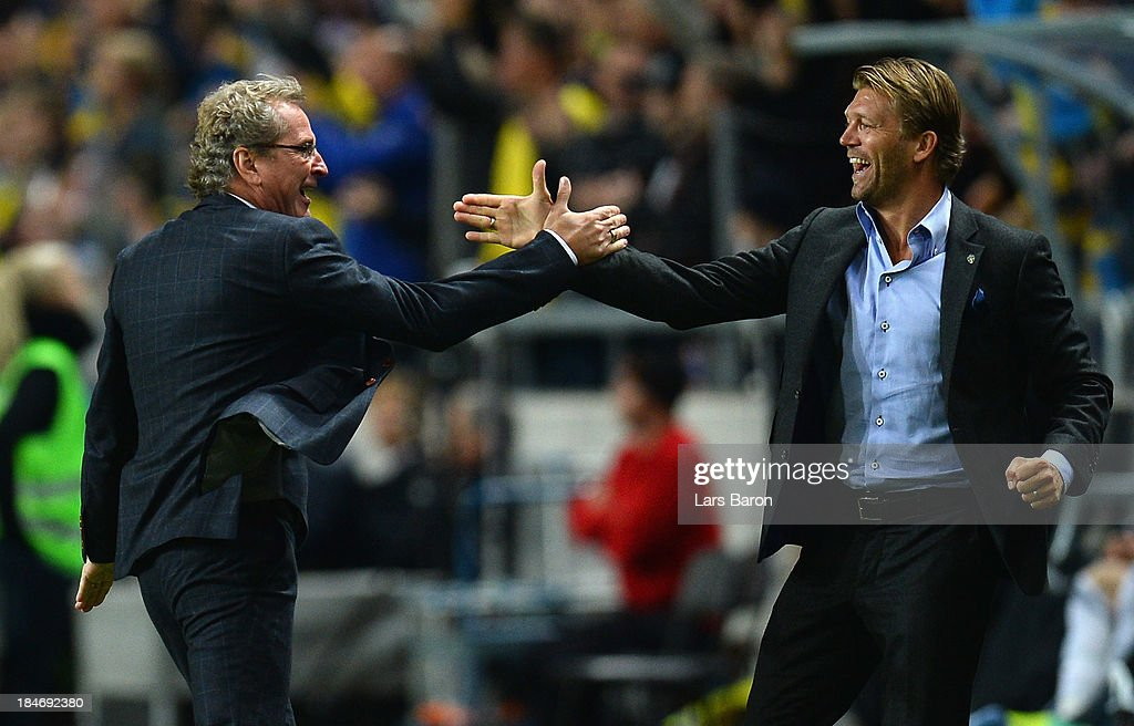 Head coach Erik Hamren of Sweden celebrates after the first goal during the FIFA 2014 World Cup Qualifying Group C match between Sweden and Germany at Friends Arena Solna on October 15, 2013 in Stockholm, Sweden.