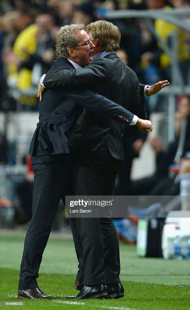 Head coach Erik Hamren of Sweden celebrates after the second goal during the FIFA 2014 World Cup Qualifying Group C match between Sweden and Germany at Friends Arena Solna on October 15, 2013 in Stockholm, Sweden.