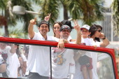 Head Coach Erik Spoelstra and Assistant Coach David Fizdale of the Miami Heat celebrate during the NBA championship parade through downtown Miami on...