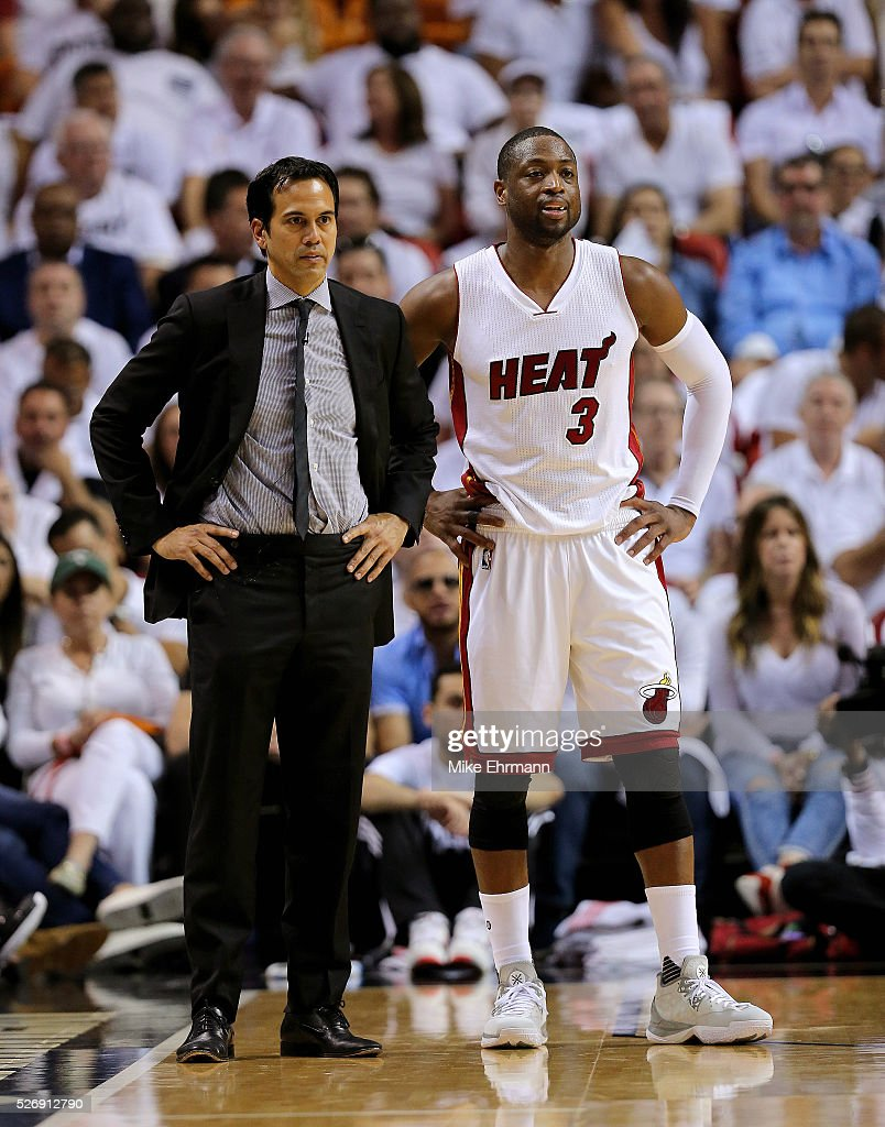 Head coach Erik Spoelstra and Dwyane Wade #3 of the Miami Heat look on during Game Seven of the Eastern Conference Quarterfinals of the 2016 NBA Playoffs against the Charlotte Hornets at American Airlines Arena on May 1, 2016 in Miami, Florida.