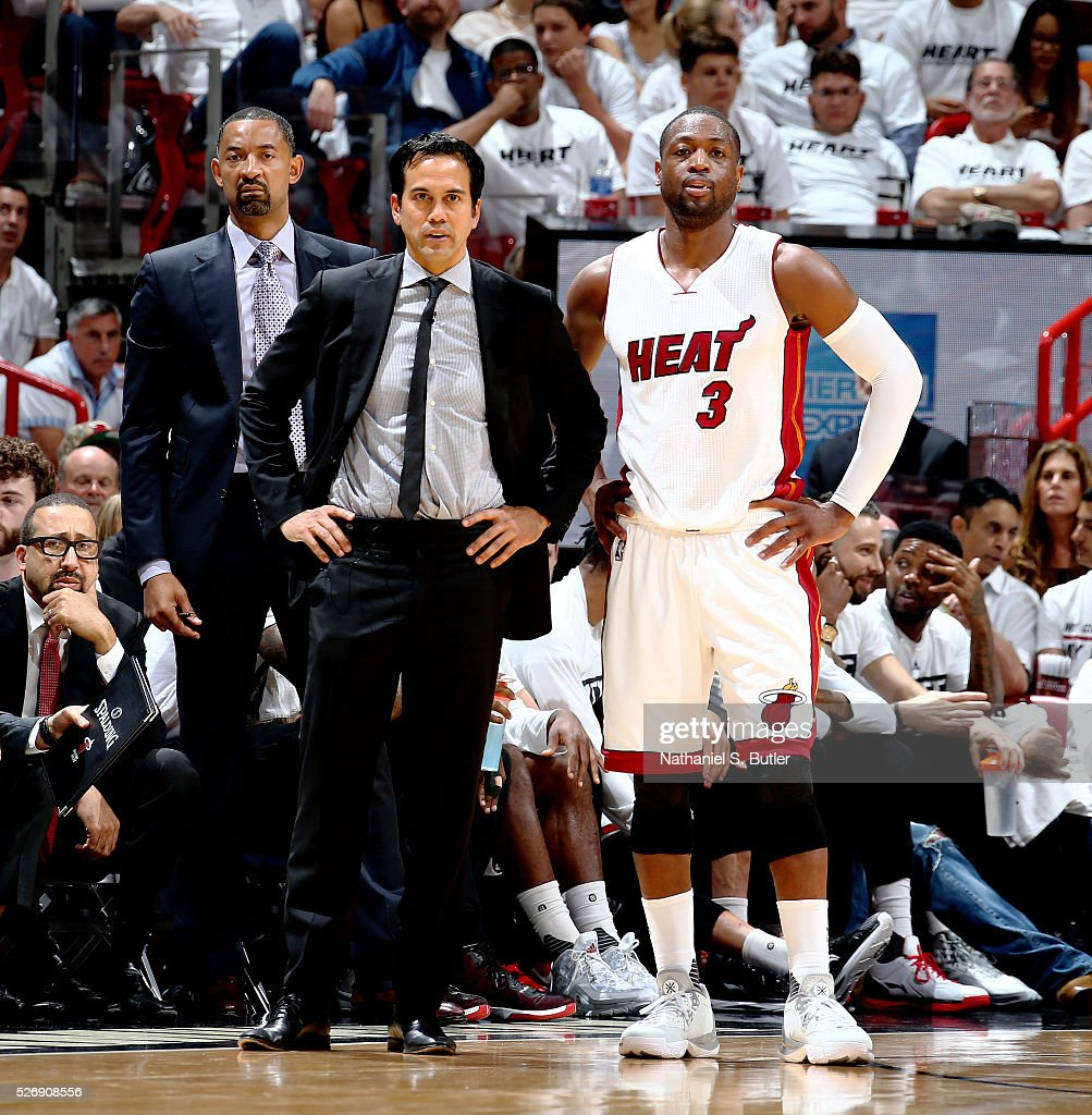 Head coach <a gi-track='captionPersonalityLinkClicked' href=/galleries/search?phrase=Erik+Spoelstra&family=editorial&specificpeople=573142 ng-click='$event.stopPropagation()'>Erik Spoelstra</a> of the Miami Heat and <a gi-track='captionPersonalityLinkClicked' href=/galleries/search?phrase=Dwyane+Wade&family=editorial&specificpeople=201481 ng-click='$event.stopPropagation()'>Dwyane Wade</a> #3 of the Miami Heat talk during the game against the Charlotte Hornets in Game Seven of the Eastern Conference Quarterfinals during the 2016 NBA Playoffs on May 1, 2016 at American Airlines Arena in Miami, Florida.