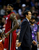 Head coach Erik Spoelstra of the Miami Heat and LeBron James of the Miami Heat during their game against the Charlotte Bobcats at Time Warner Cable...
