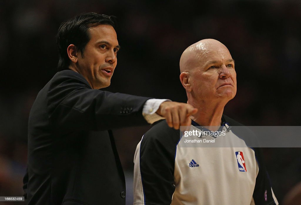 Head coach Erik Spoelstra of the Miami Heat argues a point to referee Joey Crawford #17 as the Heat take on the Chicago Bulls in Game Three of the Eastern Conference Semifinals during the 2013 NBA Playoffs at the United Center on May 10, 2013 in Chicago, Illinois.