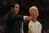 Head coach Erik Spoelstra of the Miami Heat argues a point to referee Joey Crawford as the Heat take on the Chicago Bulls in Game Three of the...