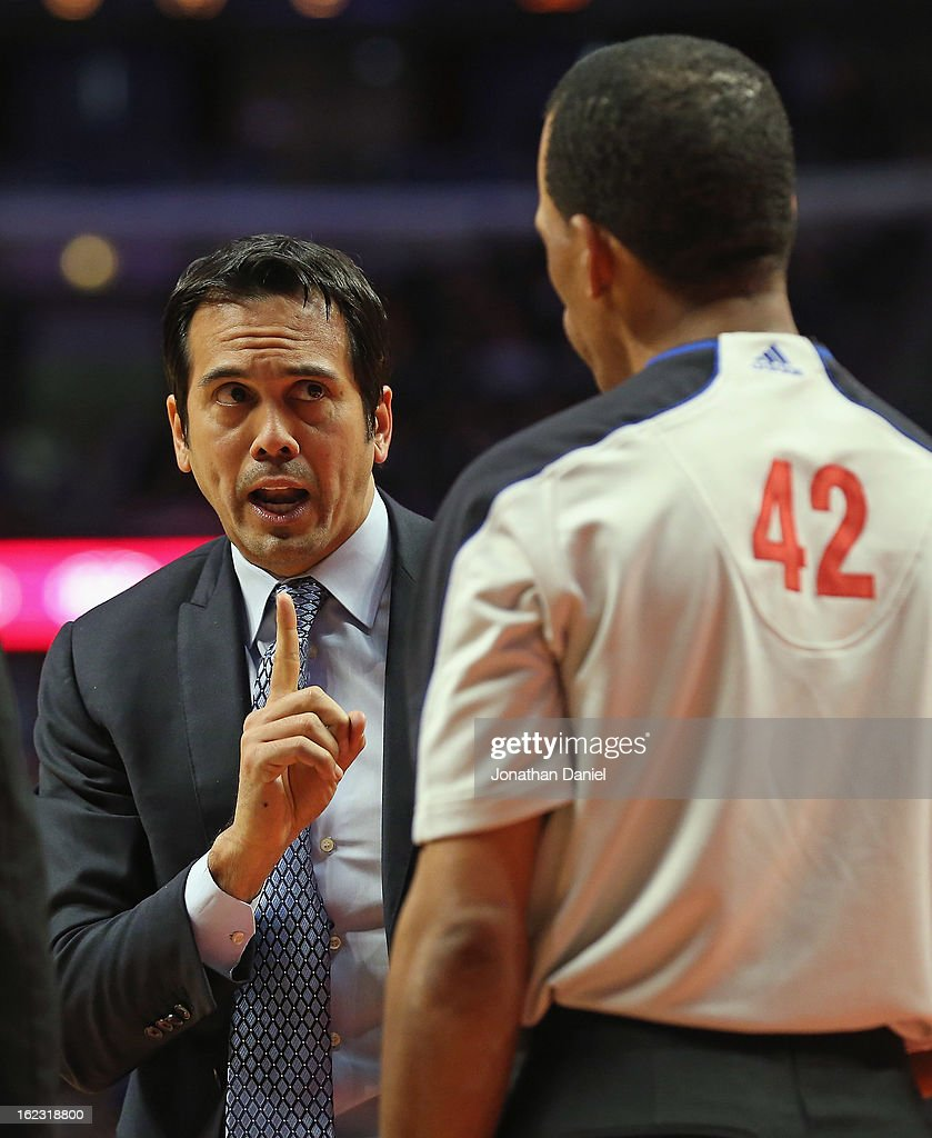 Head coach Erik Spoelstra of the Miami Heat argues with referee Eric Lewis during a game against the Chicago Bulls at the United Center on February...