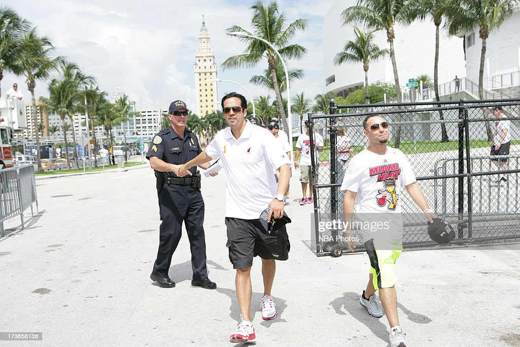 Head Coach Erik Spoelstra of the Miami Heat celebrates during the NBA championship parade through downtown Miami on June 24 2013 in Miami Florida...