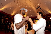 Head Coach Erik Spoelstra of the Miami Heat celebrates with LeBron James in the locker room following their team's series victory against the Indiana...