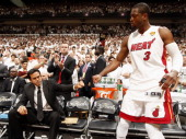 Head Coach Erik Spoelstra of the Miami Heat fist pumps Dwyane Wade prior to Game Five of the 2012 NBA Finals against the Oklahoma City Thunder at...