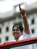 Head Coach Erik Spoelstra of the Miami Heat gestures as he rides a float during the Championship victory parade on the streets on June 24 2013 in...