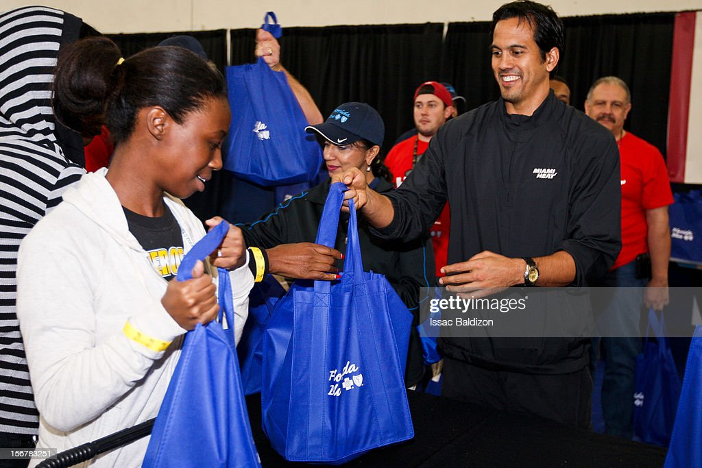 Head Coach Erik Spoelstra of the Miami Heat hands out food during the 2012 Heat Thanksgiving Celebration on November 20, 2012 at the Miami Rescue Mission in Miami, Florida.