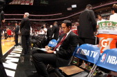 Head Coach Erik Spoelstra of the Miami Heat looks at his white board against the Charlotte Bobcats during Game Two of the Eastern Conference Finals...