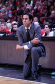 Head Coach Erik Spoelstra of the Miami Heat looks on against the Cleveland Cavaliers on December 14 2013 at American Airlines Arena in Miami Florida...