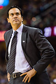 Head coach Erik Spoelstra of the Miami Heat looks to the score board during the first half Cleveland Cavaliers at Quicken Loans Arena on October 30...