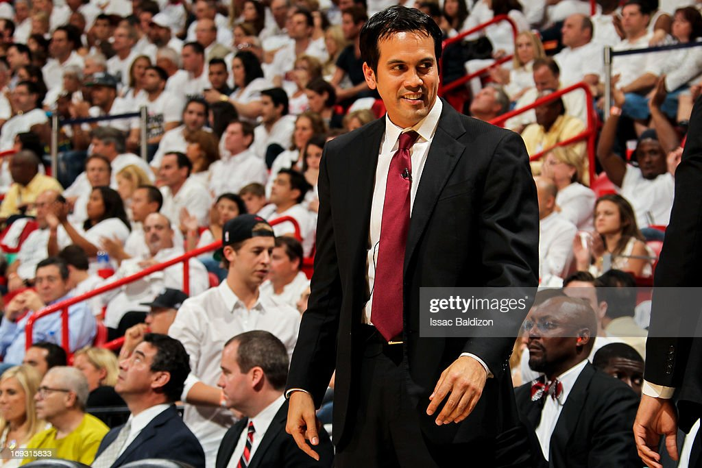 Head Coach Erik Spoelstra of the Miami Heat smiles as his team plays against the Indiana Pacers in Game One of the Eastern Conference Finals during the 2013 NBA Playoffs on May 22, 2013 at American Airlines Arena in Miami, Florida.