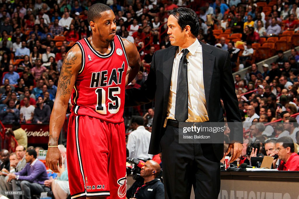 Head Coach Erik Spoelstra of the Miami Heat speaks with Mario Chalmers #15 during a game against the Los Angeles Clippers on February 8, 2013 at American Airlines Arena in Miami, Florida.