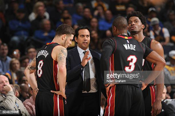 Head coach Erik Spoelstra of the Miami Heat talks to his team while facing the Golden State Warriors on January 11 2016 at Oracle Arena in Oakland...