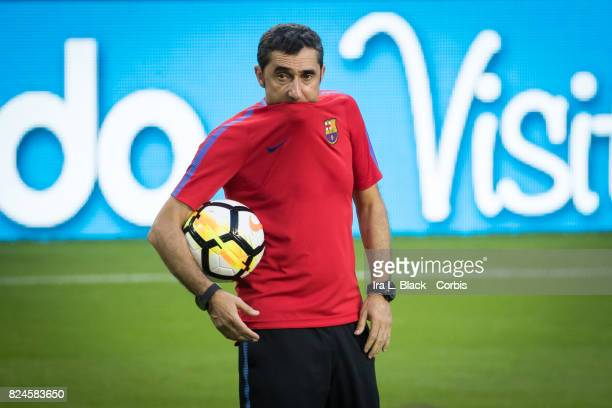 Head Coach Ernesto Valverde of Barcelona puts his shirt up onto his lip during the training session for the International Champions Cup El Clásico...