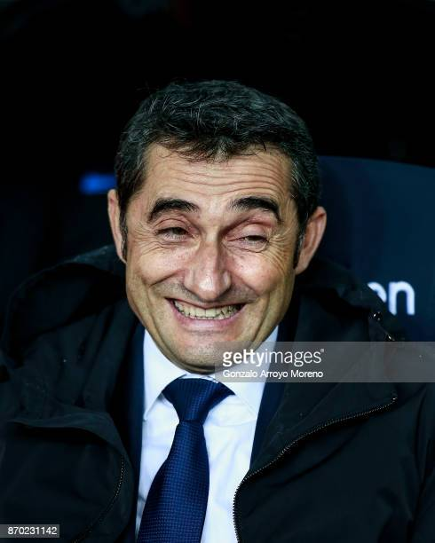 Head coach Ernesto Valverde of FC Barcelona laughs sitted on the bench prior to start the La Liga match between FC Barcelona and Sevilla FC at Camp...