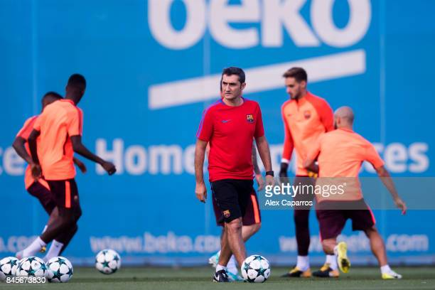 Head coach Ernesto Valverde of FC Barcelona looks on during a training session ahead of the UEFA Champions League Group D match against Juventus on...