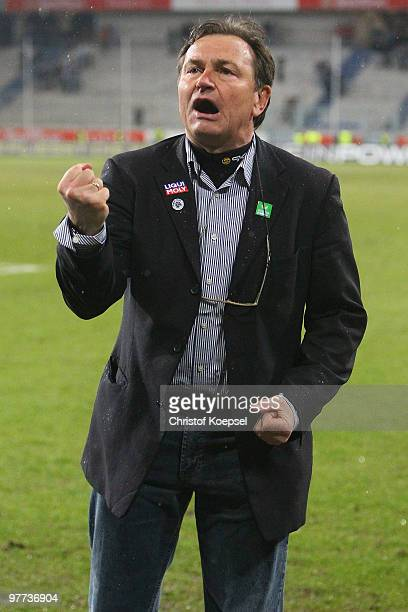 Head coach Ewald Lienen of Muenchen celebrates the 10 victory after the second Bundesliga match between MSV Duisburg and 1860 Muenchen at the MSV...