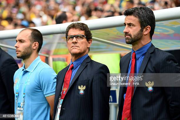 Head coach Fabio Capello and assistant coach Christian Panucci of Russia look on prior to the 2014 FIFA World Cup Brazil Group H match between...