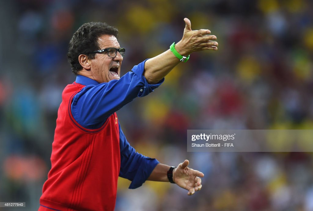 Head coach <a gi-track='captionPersonalityLinkClicked' href=/galleries/search?phrase=Fabio+Capello&family=editorial&specificpeople=241290 ng-click='$event.stopPropagation()'>Fabio Capello</a> of Russia gestures during the 2014 FIFA World Cup Brazil Group H match between Algeria and Russia at Arena da Baixada on June 26, 2014 in Curitiba, Brazil.
