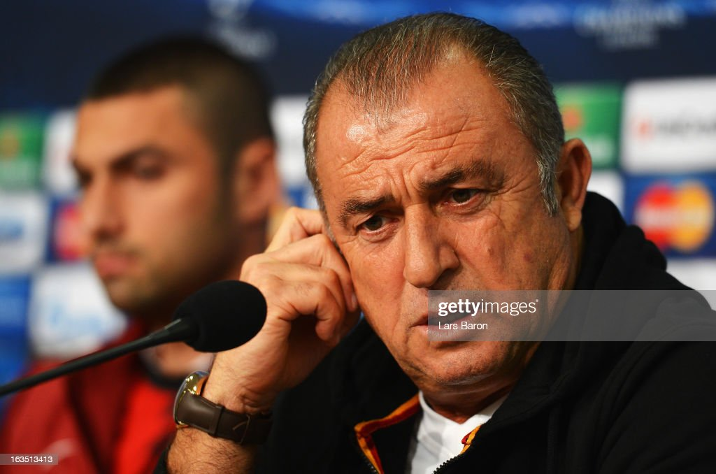 Head coach <a gi-track='captionPersonalityLinkClicked' href=/galleries/search?phrase=Fatih+Terim&family=editorial&specificpeople=602376 ng-click='$event.stopPropagation()'>Fatih Terim</a> is seen next to <a gi-track='captionPersonalityLinkClicked' href=/galleries/search?phrase=Burak+Yilmaz&family=editorial&specificpeople=8254293 ng-click='$event.stopPropagation()'>Burak Yilmaz</a> during a Galatasaray AS press conference ahead of their UEFA Champions League round of 16 match against FC Schalke 04 at Veltins Arena on March 11, 2013 in Gelsenkirchen, Germany.