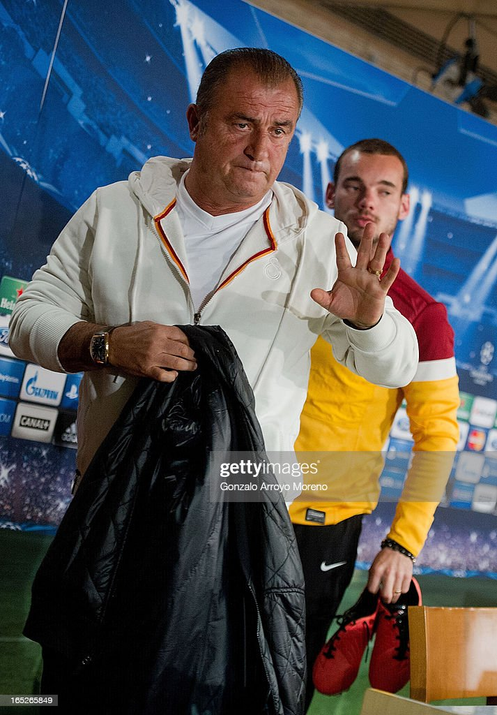 Head coach <a gi-track='captionPersonalityLinkClicked' href=/galleries/search?phrase=Fatih+Terim&family=editorial&specificpeople=602376 ng-click='$event.stopPropagation()'>Fatih Terim</a> (L) leaves the press conference room with Galatasaray player <a gi-track='captionPersonalityLinkClicked' href=/galleries/search?phrase=Wesley+Sneijder&family=editorial&specificpeople=538145 ng-click='$event.stopPropagation()'>Wesley Sneijder</a> after a press conference ahead of the UEFA Champions League Quarterfinal match between Real Madrid and Galatasaray AS at Santiago Bernabeu Stadium on April 2, 2013 in Madrid, Spain.