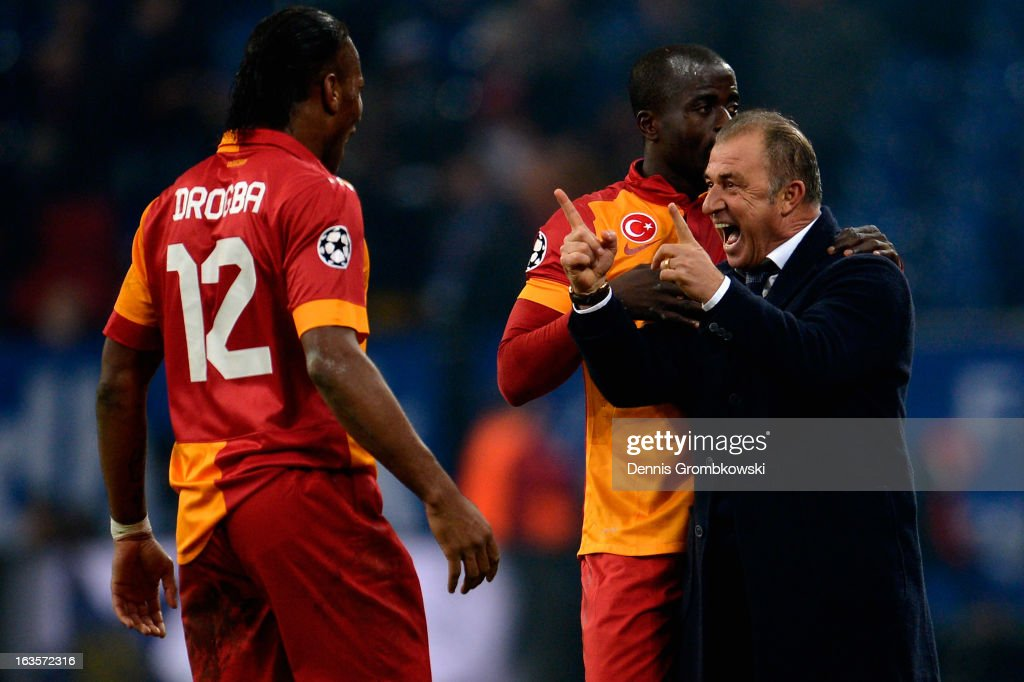 Head coach <a gi-track='captionPersonalityLinkClicked' href=/galleries/search?phrase=Fatih+Terim&family=editorial&specificpeople=602376 ng-click='$event.stopPropagation()'>Fatih Terim</a> of Galatasaray celebrates with <a gi-track='captionPersonalityLinkClicked' href=/galleries/search?phrase=Didier+Drogba&family=editorial&specificpeople=179398 ng-click='$event.stopPropagation()'>Didier Drogba</a> and Dany Nounkeu during the UEFA Champions League round of 16 second leg match between Schalke 04 and Galatasaray AS at Veltins-Arena on March 12, 2013 in Gelsenkirchen, Germany.