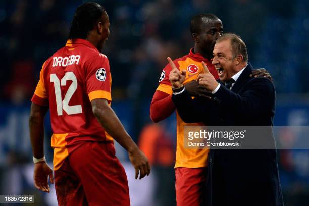 Head coach Fatih Terim of Galatasaray celebrates with Didier Drogba and Dany Nounkeu during the UEFA Champions League round of 16 second leg match...