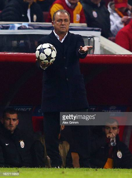 Head coach Fatih Terim of Galatasaray holds the ball during the UEFA Champions League Round of 16 first leg match between Galatasaray and FC Schalke...