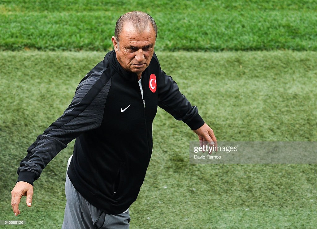 Head coach <a gi-track='captionPersonalityLinkClicked' href=/galleries/search?phrase=Fatih+Terim&family=editorial&specificpeople=602376 ng-click='$event.stopPropagation()'>Fatih Terim</a> of Turkey reacts during a training session ahead of their UEFA Euro 2016 Group D match against Spain at Allianz Riviera Stadium on June 16, 2016 in Nice, France.