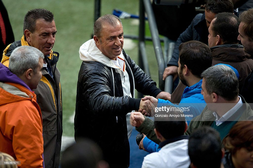 Head coach <a gi-track='captionPersonalityLinkClicked' href=/galleries/search?phrase=Fatih+Terim&family=editorial&specificpeople=602376 ng-click='$event.stopPropagation()'>Fatih Terim</a> shakes hands with journalists during a training session ahead of the UEFA Champions League Quarterfinal match between Real Madrid and Galatasaray AS at Estadio Santiago Bernabeu on April 2, 2013 in Madrid, Spain.