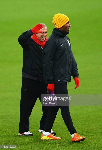 Head coach Fatih Terim smiles with Didier Drogba during a Galatasaray AS training session ahead of their UEFA Champions League round of 16 match...