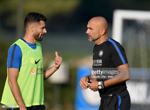 Head coach FC Internazionale Luciano Spalletti and Antonio Candreva chat during the training session at Suning Training Center at Appiano Gentile on...