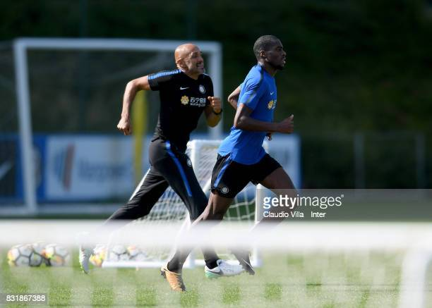 Head coach FC Internazionale Luciano Spalletti and Geoffrey Kondogbia in action during a training session at Suning Training Center at Appiano...