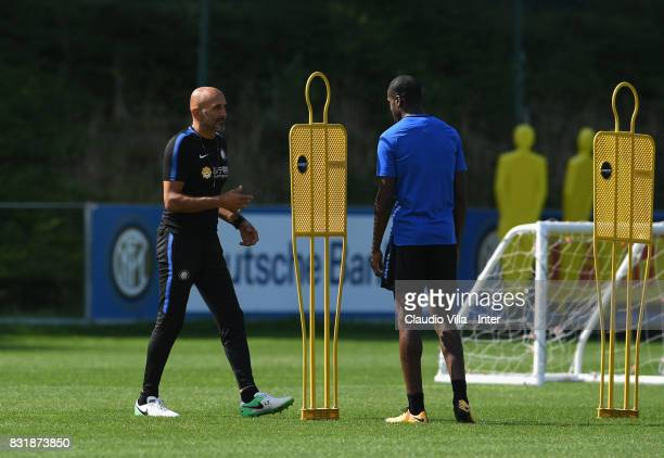 Head coach FC Internazionale Luciano Spalletti and Geoffrey Kondogbia chat during a training session at Suning Training Center at Appiano Gentile on...