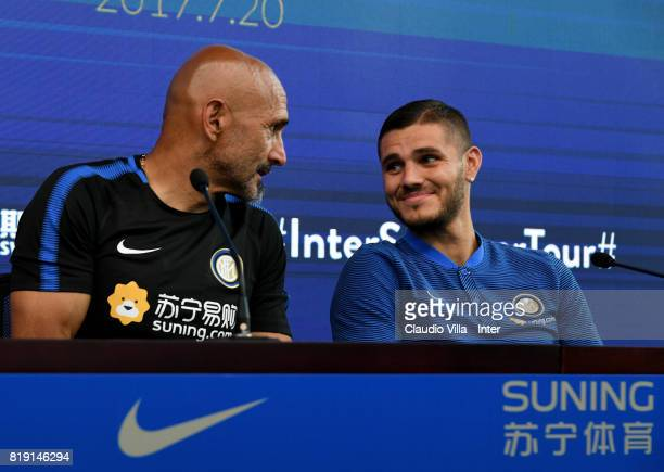 Head coach FC Internazionale Luciano Spalletti and Mauro Icardi chat during a press conference at Suning Training Center on July 20 2017 in Nanjing...