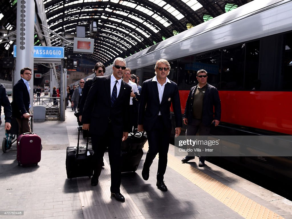 Head coach FC Internazionale Roberto Mancini (R) and CEO of FC Internazionale Milano Michael Bolingbroke depart to Rome at train station on May 9, 2015 in Milano, Italy.