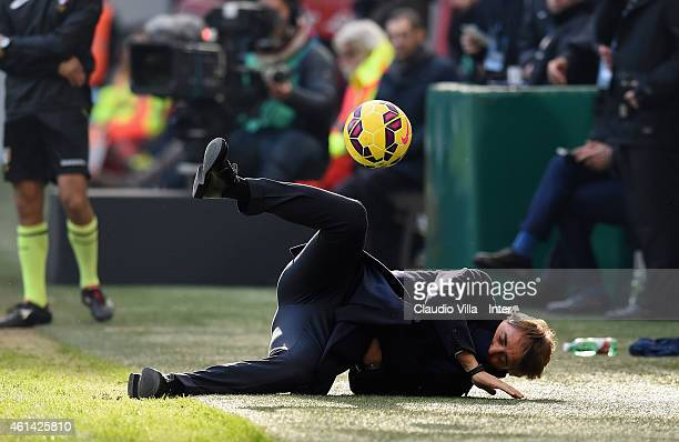 Head coach FC Internazionale Roberto Mancini falls to the ground after being struck by a ball on the touchline during the Serie A match between FC...